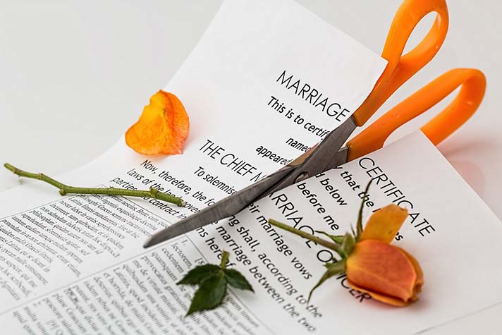 Cutting Up Marriage Certificate