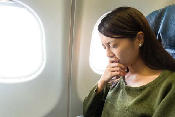 Anxious Woman Sat on Plane