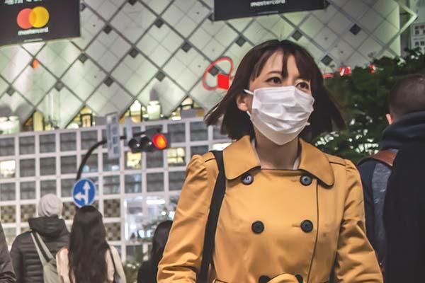 Asian Girl Wearing Breathing Mask