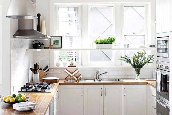 White Shaker Kitchen with Wood Counter