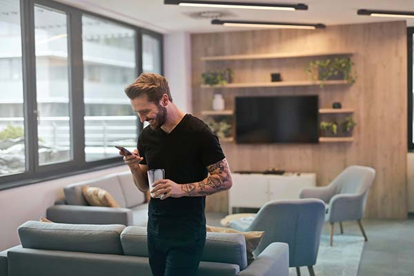 Guy Smiling Reading SMS