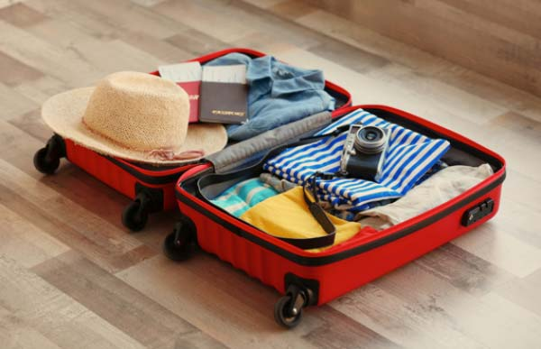 Open Suitcase Packed with Clothes