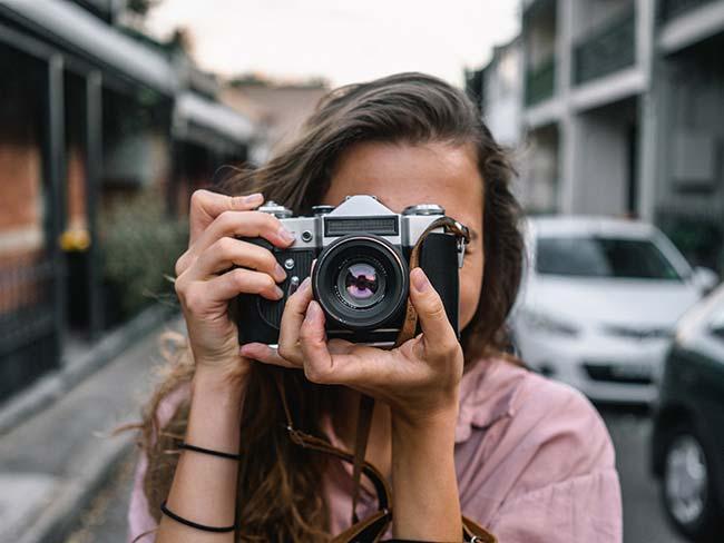 Girl Using SLR Camera