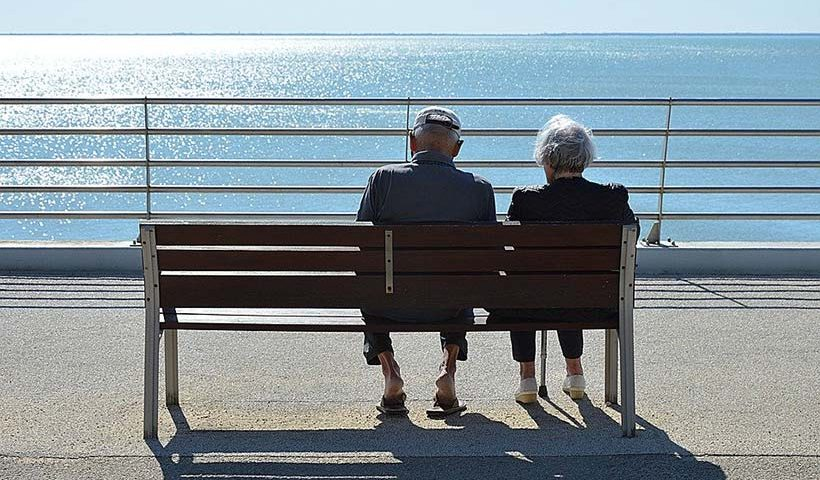 Elderly Couple Looking Out to Sea