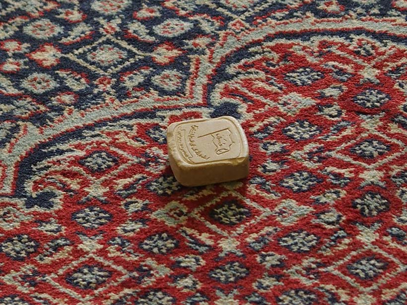 Prayer Stone on Persian Rug