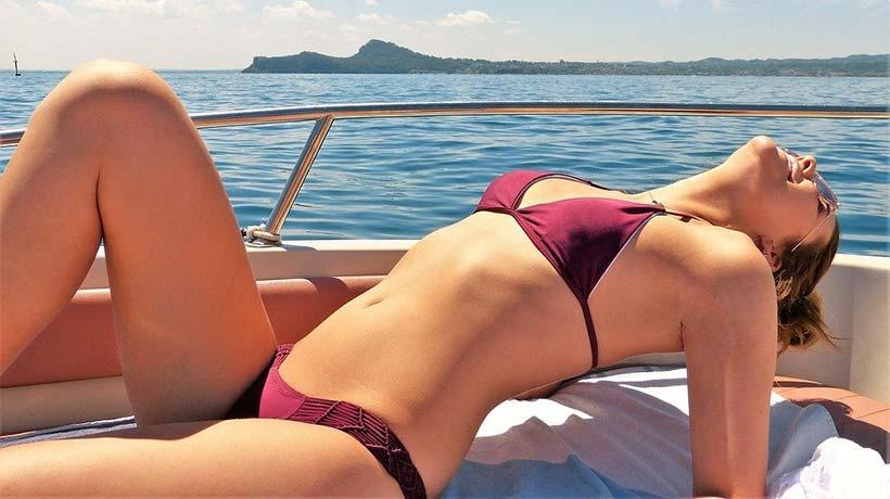 Woman Sunbathing on a Boat