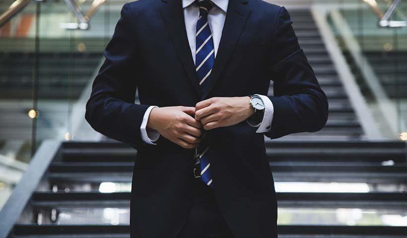 Man Buttoning Suit Jacket