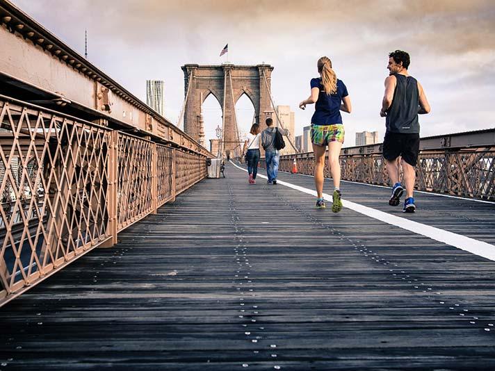 Couple Jogging on Brooklyn Bridge
