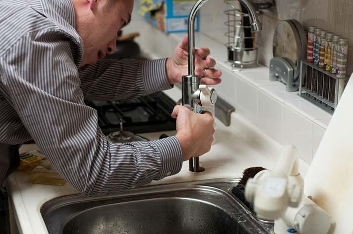 Plumber Repairing a Tap