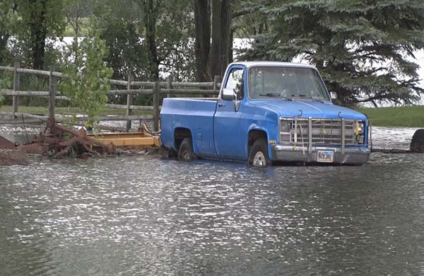 Old Pickup Truck Stuck in Flood Waters