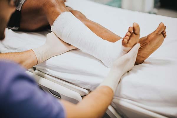 Holding Bandaged Leg