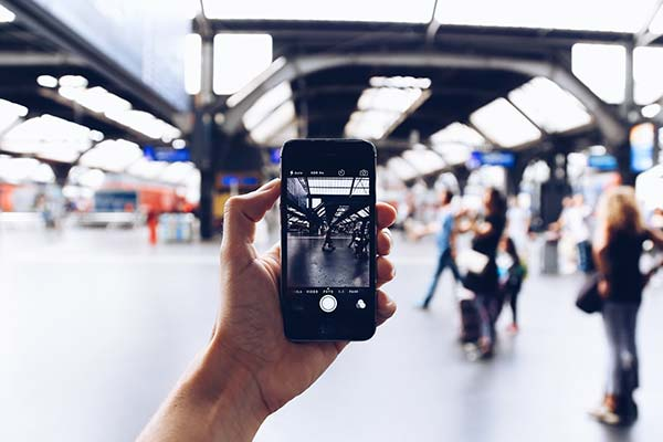 Holding iPhone at Railway Station