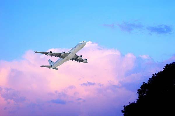Plane Taking Off Against Purple Skies