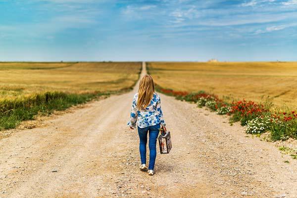 Girl Walking Carrying Suitcase