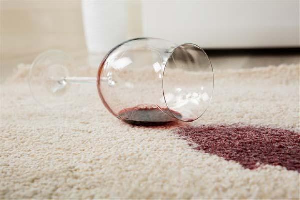 Glass of Red Wine Spilt on Carpet