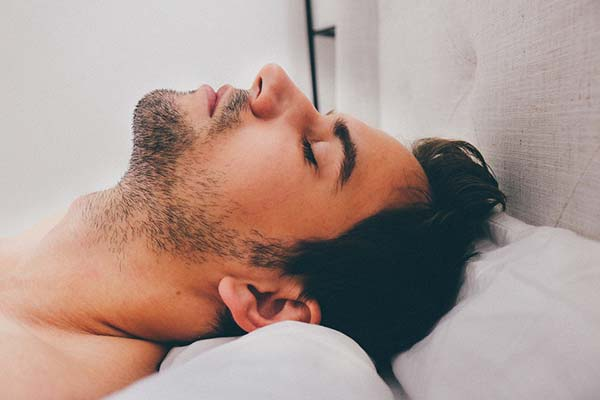 Man Sleeping with Neck Support