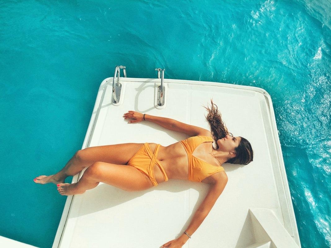 Beautiful Young Woman Sunbathing