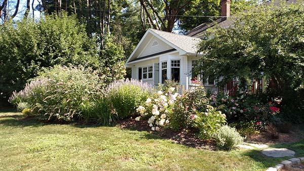 House with Beautiful Flowered Front Yard