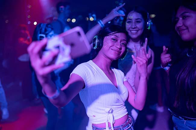 Girls in Nightclub Taking Selfie