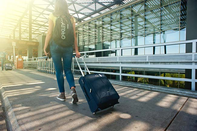 Girl Pulling Suitcase at Airport