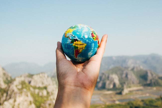 Holding a Small Earth Globe