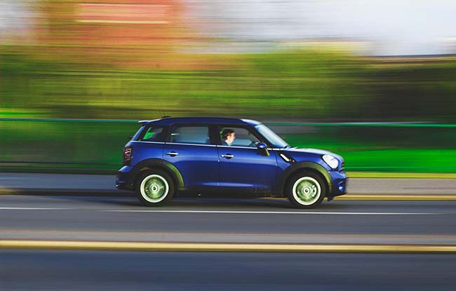 Man Driving Mini on Highway