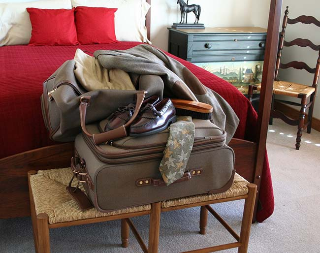 Suitcase & Clothes on Bed