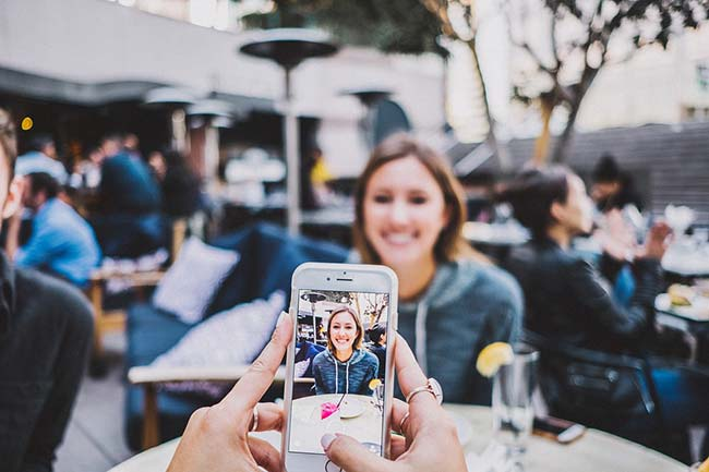 Taking Picture of Girl Using Phone