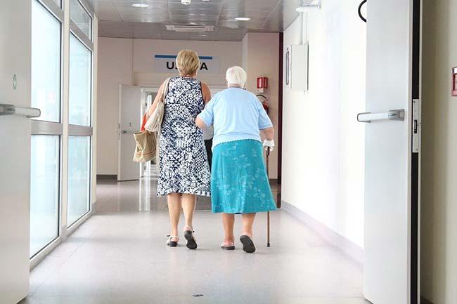 Lady Helping Senior Citizen Walk