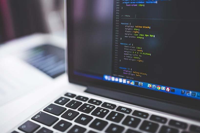 Developer Coding on Laptop