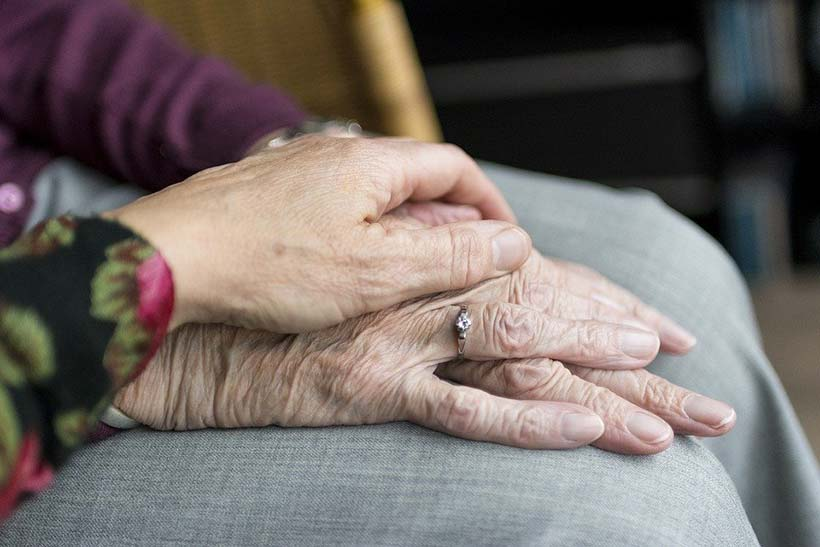 Holding an Elderly Lady's Hand