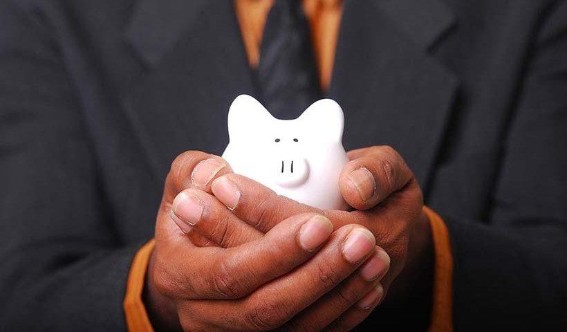 Piggy Bank Held in Cupped Hands
