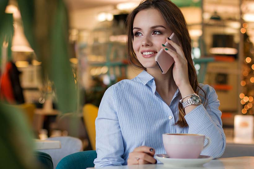 Young Woman on Phone with Coffee