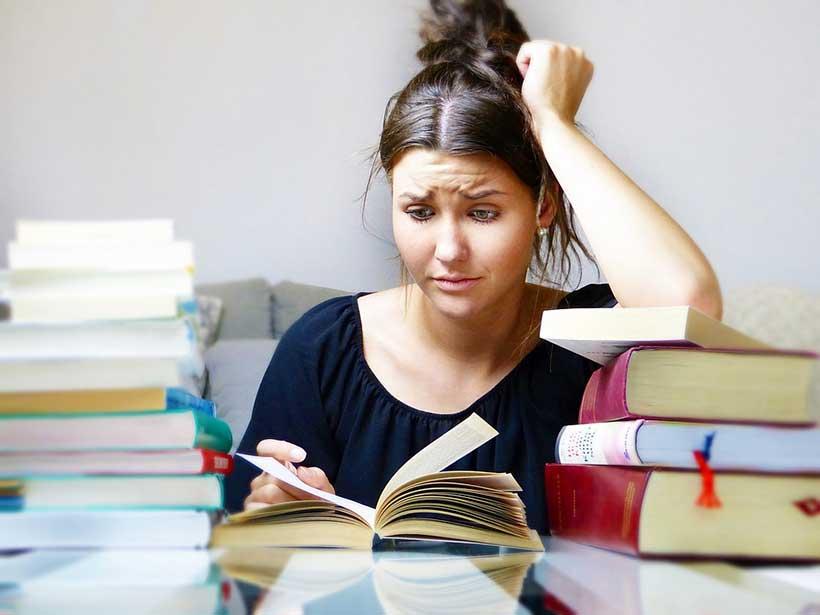 Stressed Girl Reading Books