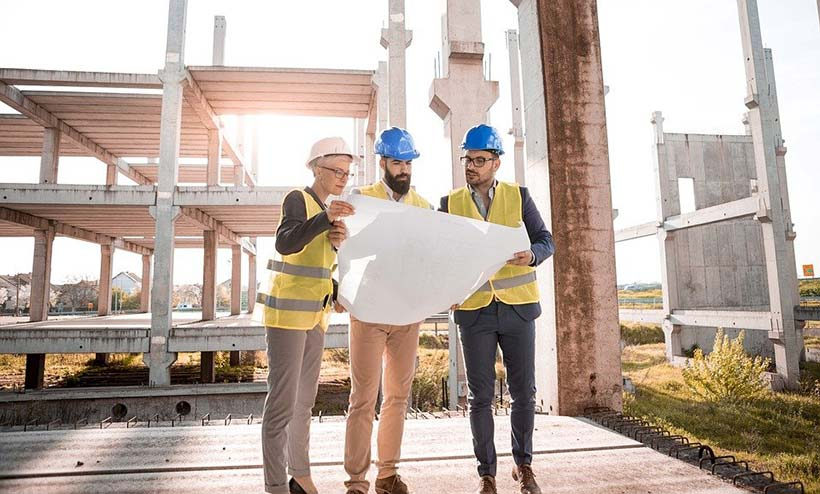 3 People Reviewing Architects Drawings