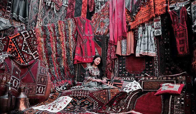 Asian Woman Selling Carpets