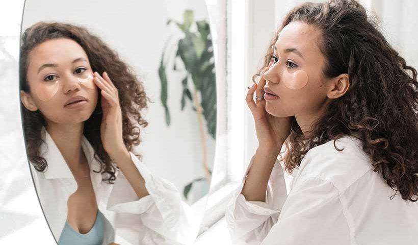 Girl Applying Eye Skin Care