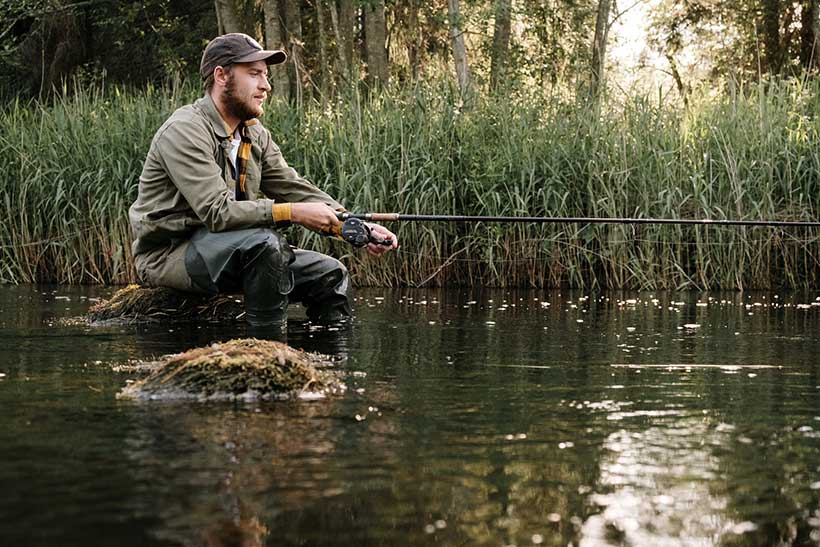 Man Sat Fishing in a River
